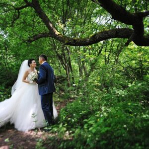 beautiful happy wedding couple at the forest