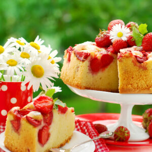 strawberry sponge cake with fresh fruits decoration on table in the garden ** Note: Shallow depth of field