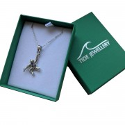 chimp necklace in box with lid