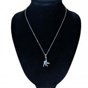 chimp necklace on stand 1