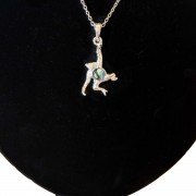 chimp necklace on stand