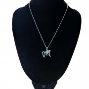 monkey necklace on stand
