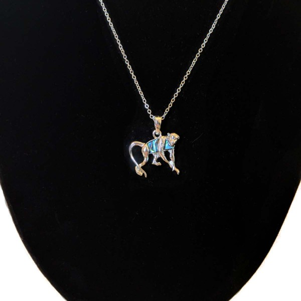 monkey necklace on stand closer